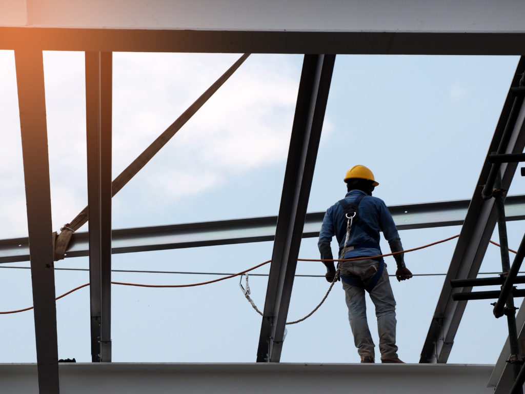 Man working in a fall risk position